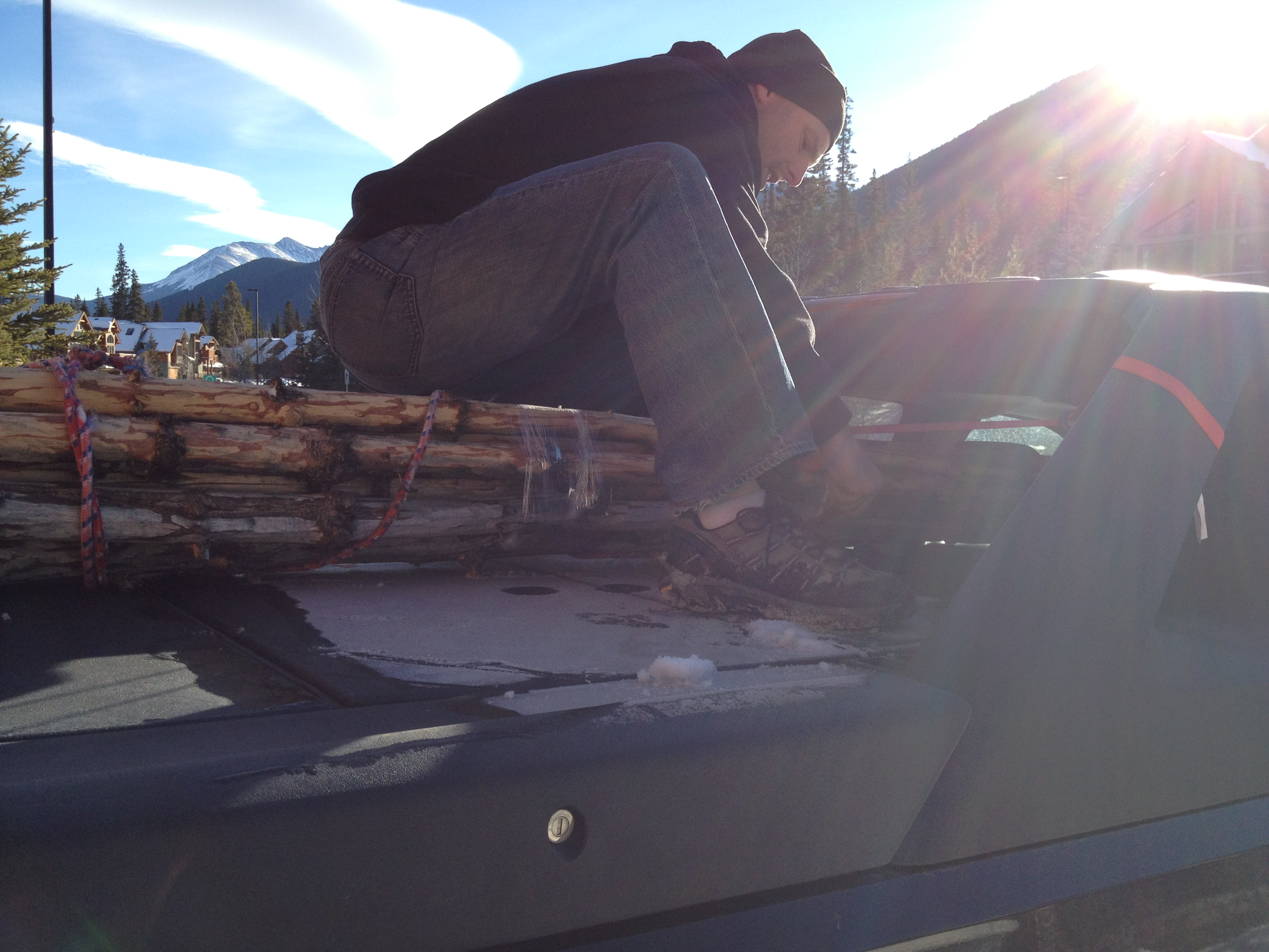 Kevin straps the tipi installation to the truck on a cold December morning.