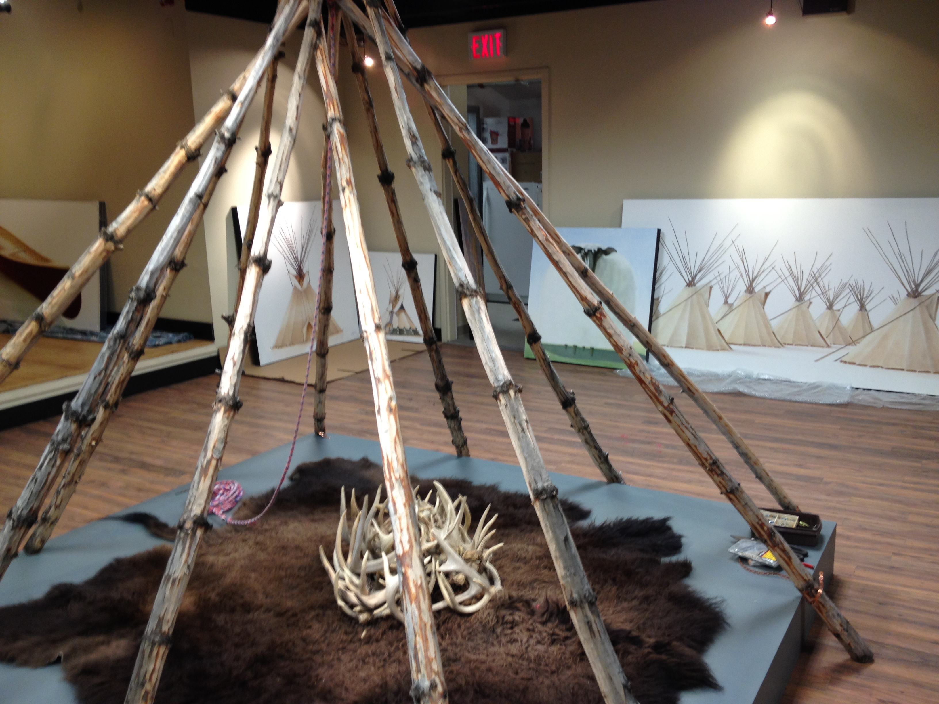 Setting up the CAMP exhibition by Janice Tanton at the Okotoks Art Gallery