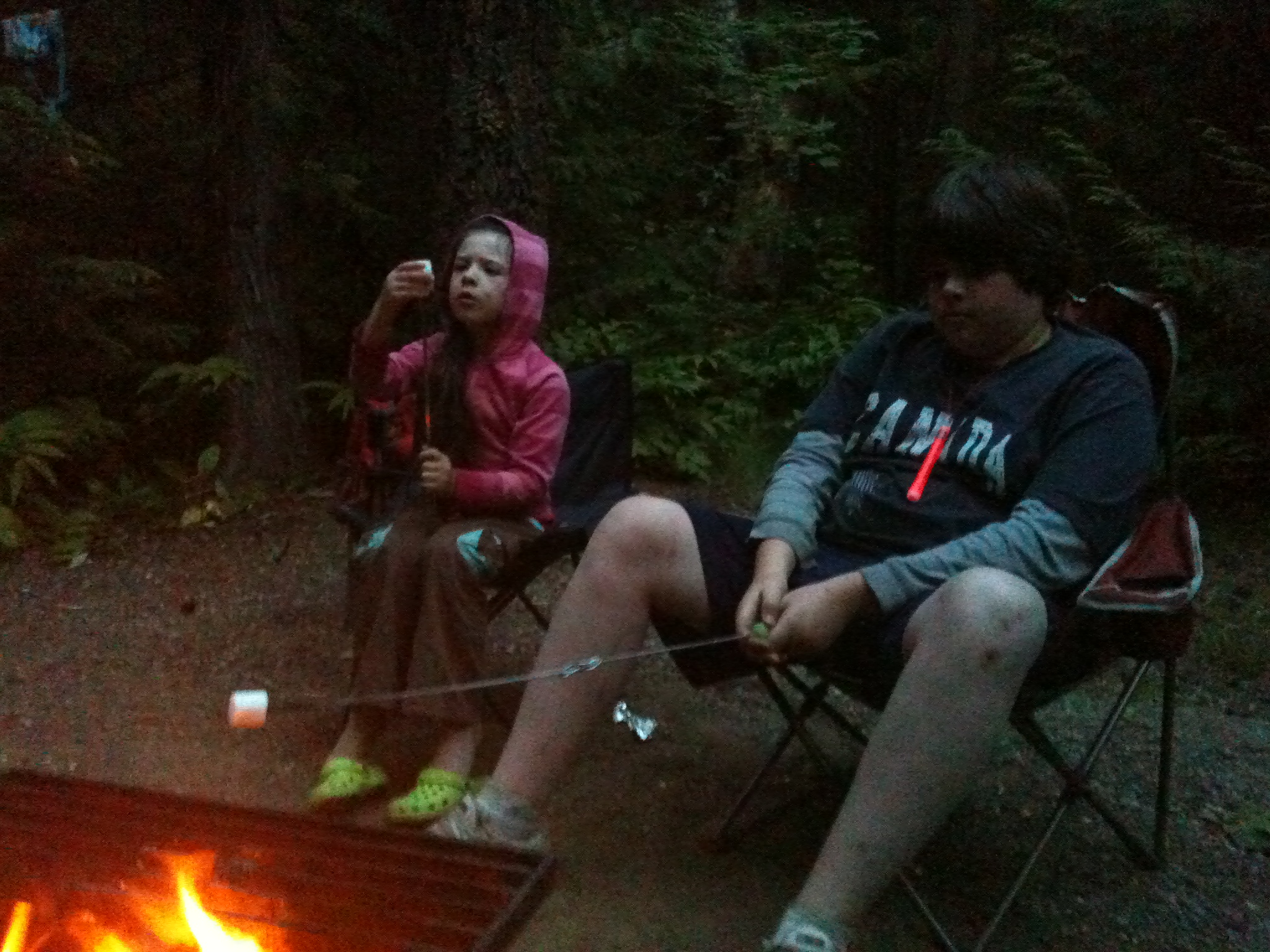 Grace and Ben Roast Marshmellows over a campfire at the Shuswap
